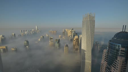 impressive skyline : high-rise buildings in Dubai in the morning fog (time-lapse)
