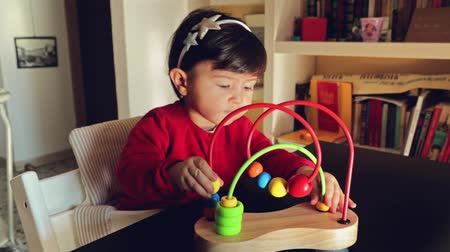 abacus : Joyful baby playing with a colorful toy