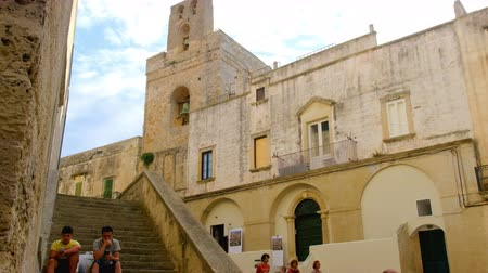 Otranto, Italy kids sit stairs old town outside Otranto basil
