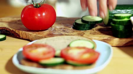 okurka : slicing tomatoes and cucumber