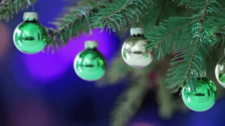 Christmas baubles on the background of flashing lights Stok Video