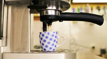 cooks : Espresso is poured into a cup of coffee Stock Footage