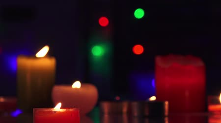 церковь : Tracking shot of Christmas candles and flashing light bulbs on a background