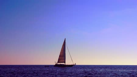 serene : Sailboat at sunset