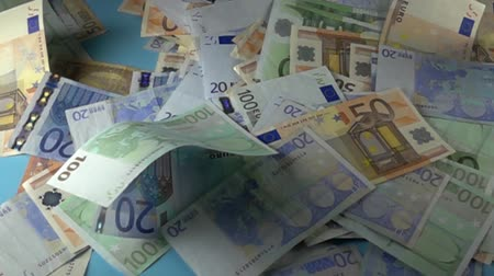 enriching : Different Euro bills falling down in a money rain slow motion 1000 fps