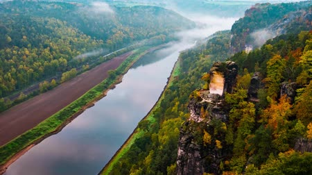 švýcarský : View from viewpoint of Bastei in Saxon Switzerland Germany to the town city and the river Elbe on a sunny day in autumn