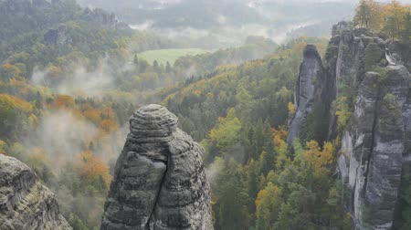 morning : timelapse of sunrise over Mountains. morning mist in the valley Bastei in Saxon Switzerland