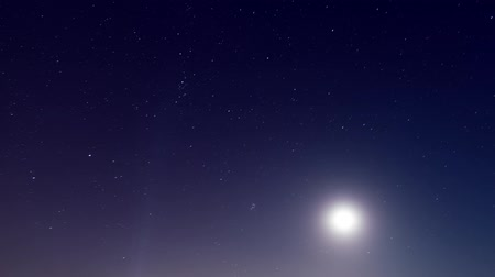 fullmoon : moon and stars on black night sky time lapse Stock Footage