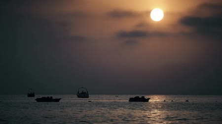berrante : Boats On Calm Sea At Sunset