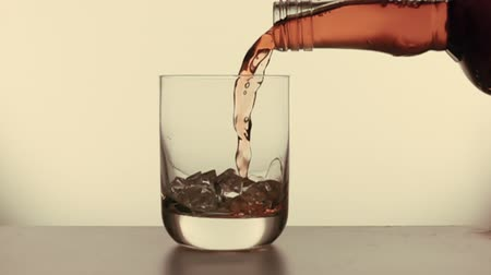 Water is poured into a glass slow motion Стоковые видеозаписи