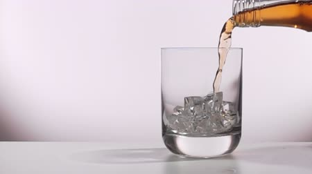 drink is poured into a glass in a slow motion.
