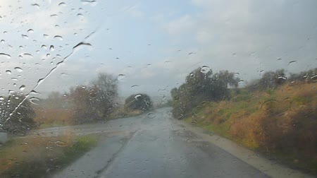 previously : a ride in a car in the rain wipering the water Stock Footage