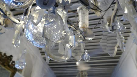 csillár : detail of an old crystal ceiling light with a rotating fan