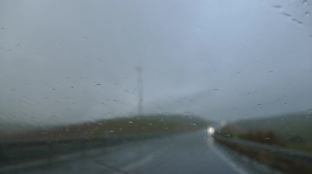 driving a car in a heavy rain on the road