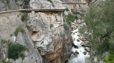 wooden bridge : beautiful rocky landscape of camino del rey at el chorro in andalusia in spain