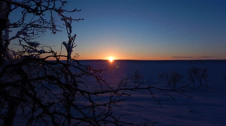 timelapse of a sunset in winter lappland