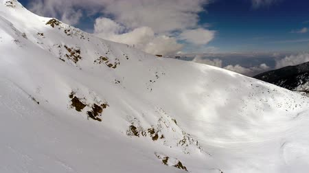 pohoří : AERIAL: Flight over mountain covered with snow  - winter