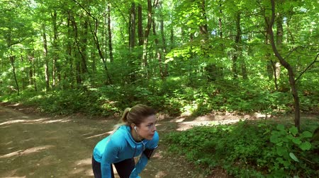 Runners - running jogging in forest. People training, running, jogging, fitness, runner-4k video