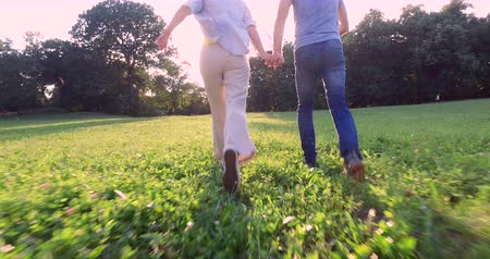 Happy couple running together in park