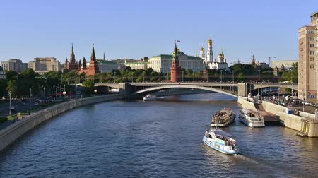 Time-lapse. Summer ships traffic on Moscow river near the Kremlin, Moscow, Russia.