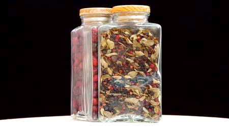 rosehips : Dried cranberries, blueberries and rosehip spins in glass bottles.