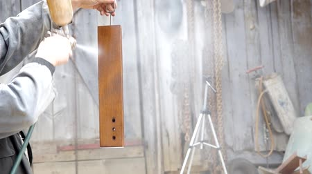 madeira : Spray varnish on a wooden board