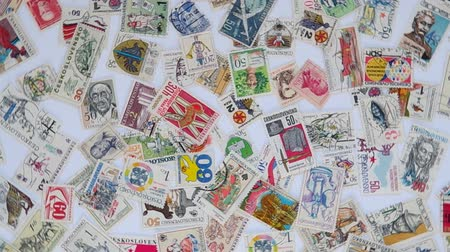 pul : Old Czechoslovak stamps  are spinning on a table. Stok Video