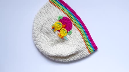 шляпа : Girls Crochet hat are rotated on the table.