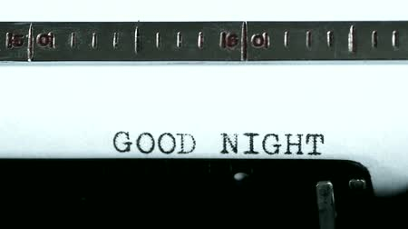 good : Typewriting on an old typewriter. Typing text: good night