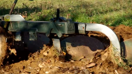 dirt : Tractor plowing land in the orchard in Autumn Stock Footage
