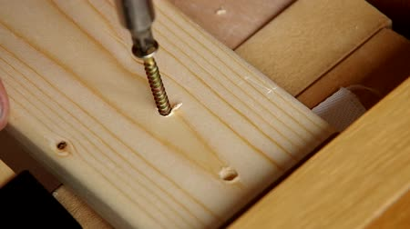 steel : Use screw machine for insert screw into the wood Stock Footage