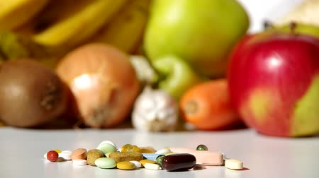 vitamin : Health have just one, so well have vegetables and fruit or medicines? Stock mozgókép