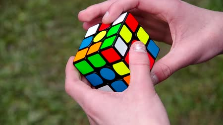 cubos : Folding the Rubiks Cube on green background