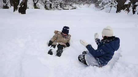 rodzeństwo : Cute Asian children playing on snow in the park together , Aomori Japan Wideo