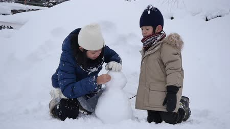 Cute Asian children playing on snow in the park together , Aomori Japan Wideo