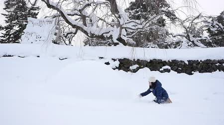 Cute Asian girl playing on snow in the park together , Aomori Japan Wideo