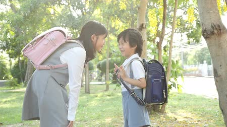 söz : Cute Asian children going to the school outdoors slow motion
