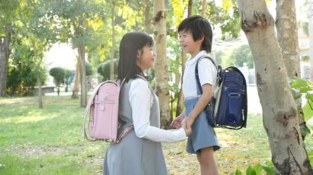 klasa : Cute Asian children going to the school outdoors slow motion