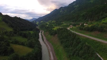 брезент : flight over a river valley in the alps, aerial view from the mountain in summer Austria