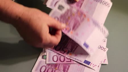 pago : Counting money - big euro banknotes. Paying money or being paid. Europe banknotes
