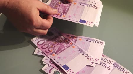 pago : Counting money - big euro banknotes. Paying money or being paid.