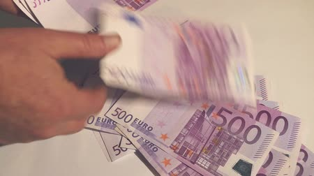 pago : Counting money - big euro banknotes. Paying money or being paid. Europe bank Vídeos