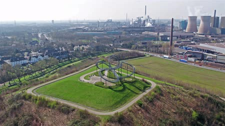 points of interest : Duisburg, Germany - March 24 2017 : Landmark Tiger and Turtle standing on a hill with HKM producing steel in the background, aerial