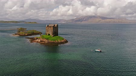 argyll : Aerial shot of medieval Castle Stalker on the west coast of Scotland by Appin
