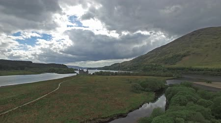 argyll : The ruins of historic Kilchurn Castle and jetty on Loch Awe
