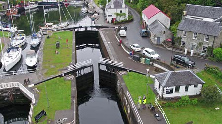 argyll : Aerial view of the beautiful historic harbour village of Crinan - Locks opening Part 01 Stock Footage