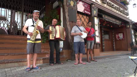 urge : Ruedesheim  Germany - June 22 2017 : Busking musicians demanding more money of the bypassing people