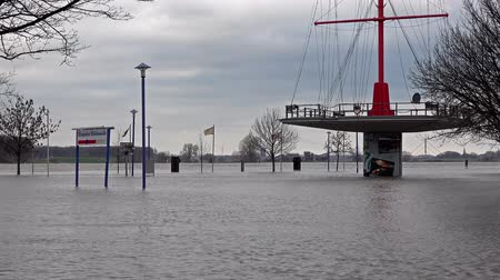 handrails : Duisburg  Germany - January 08 2017 : The Muehlenweide is flooded by the river Rhine