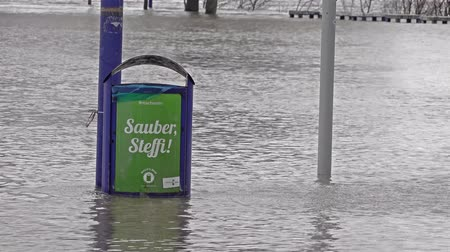 söğüt : Duisburg  Germany - January 08 2017 : Dustbin flooded by the river Rhine