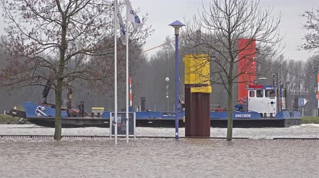vodoznak : Duisburg  Germany - January 08 2017 : Hafag 38 passing theflooded promenade